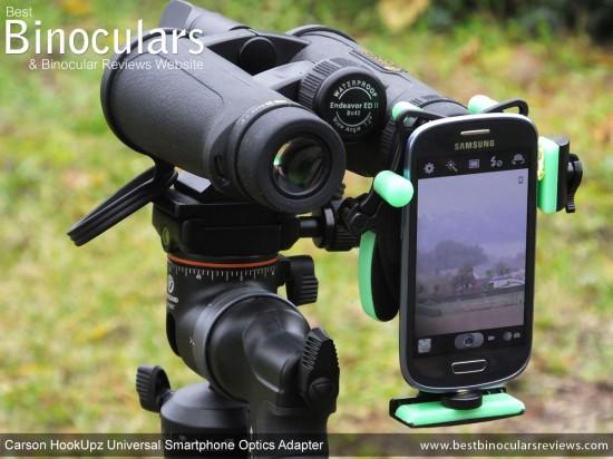 Carson HookUpz Universal Smartphone Optics Adapter attached to binoculars  & smartphone