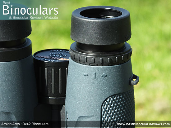 Lockable Diopter Adjustment on the central focus wheel of the Athlon Ares 10x42 Binoculars