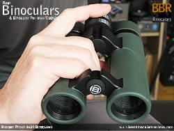 Holding the Bresser Pirsch 8x34 Binoculars