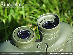 One of the Eyecups fully folded down on the Celestron Cavalry 7x50 Binoculars