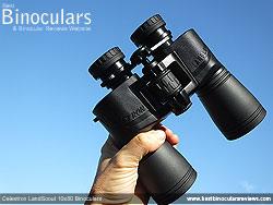 Me holding the Celestron LandScout 10x50 Binoculars
