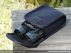 Levenhuk Atom 10x25 Binoculars in their protective pouch