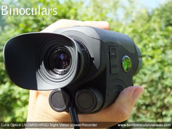 Me holdling the Luna Optics LN-DM50-HRSD Digital Night Vision Viewer/Recorder