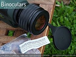 Color enhancing filter and the Objective Lens Cover on the Luna Optics LN-DM60-HD Digital Night Vision Monocular & Recorder mounted on a tripod