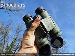 Me holding the Meade Wilderness 10x32 Binoculars
