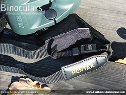 Neck strap on the Pentax AD 9x32 WP Binoculars