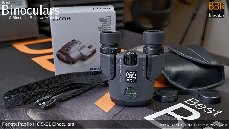 Pentax Papilio II 8.5x21 Binoculars with neck strap, carry case and lens covers