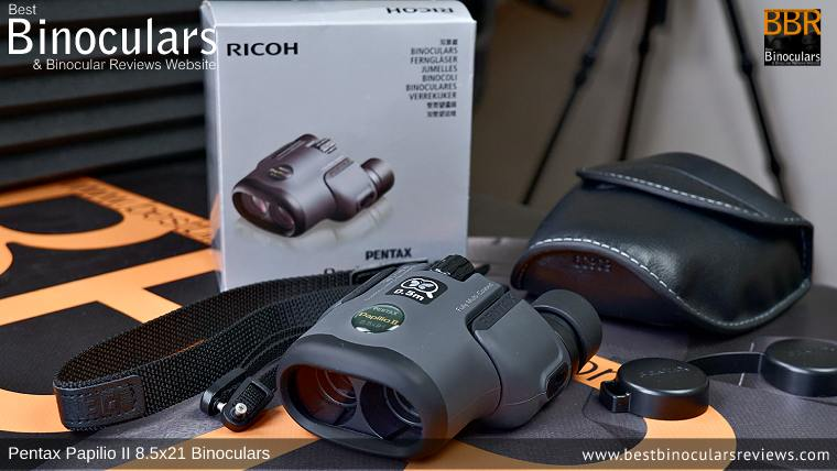 Carry Case, Neck Strap, Cleaning Cloth, Lens Covers & the Pentax Papilio II 8.5x21 Binoculars