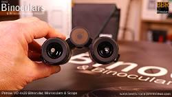 Holding the Compact Pentax VD 4x20 Binoculars, Monocular & Spotting Scope