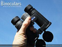 Holding the Snypex Knight D-ED 8x32 Binoculars