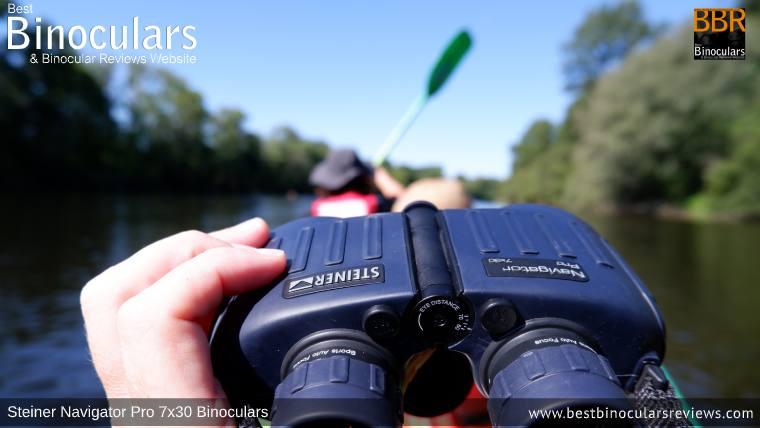 Holding the Steiner Navigator Pro 7x30 binoculars