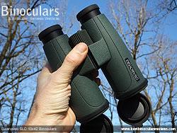 Hand holding the Swarovski SLC 10x42  Binoculars