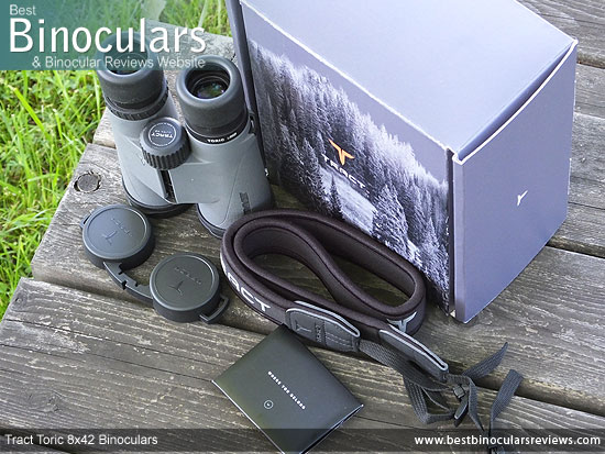 Tract Toric 8x42 Binoculars with neck strap, carry case and lens covers
