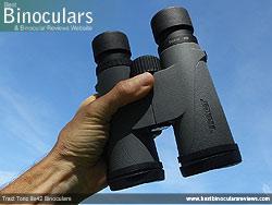 Holding the Tract Toric 8x42 Binoculars