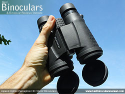 Hand holding the Upland Optics Perception HD 10x42 Binoculars