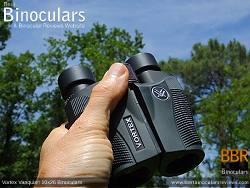 Holding the Compact Vortex Vanquish 10x26 Binoculars