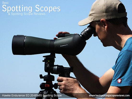 Me focusing the Hawke Endurance ED 20-60x85 Spotting Scope mounted on a tripod using a pistol grip