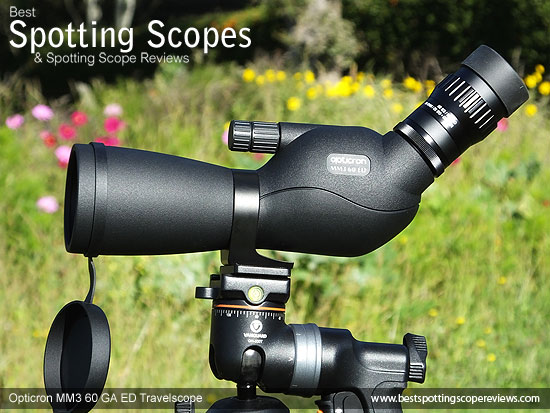 Side view of the Opticron MM3 60 GA ED Travelscope mounted on a tripod using a pistol grip